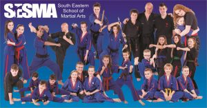 SESMA Martial arts group photo of karate and kickboxing students training