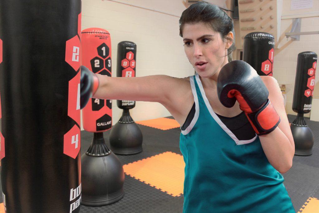 Young female kickboxer training